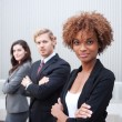 Attractive young business group standing together at office — Stock Photo #13486167