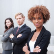 Stock Photo: Attractive young business group standing together at office