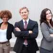Attractive young business group standing together at office — Stock Photo #13486172