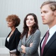 Attractive young business group standing together at office — Stock Photo