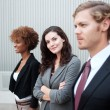 Attractive young business group standing together at office — Stock Photo #13486186