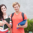 Royalty-Free Stock Photo: Happy pair of college students