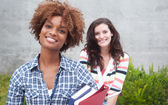 Happy pair of college students — Stock Photo