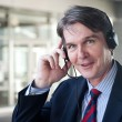 Portrait of a mature businessman with headset — Stock Photo