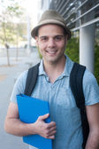 Happy young male student — Stock Photo