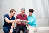 Family on tablet — Foto Stock