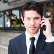 Portrait of handsome, young business man using cell phone — Stock Photo #9842576