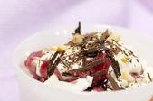 Dessert with cream, chocolate nuts and jam — Stock Photo