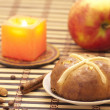 Royalty-Free Stock Photo: Cross bun with raisin and dried apricots