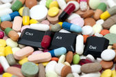 Ctrl, Alt, Del keys among drugs (Enter system, restart system) — Stock Photo
