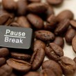 Pause, break key among coffee beans — Stock Photo