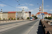 Prague cityscape with old buildings and modern tram — Stock Photo