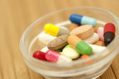 Various drugs in small salad bowl — Stock Photo