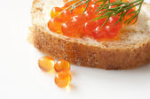 Sandwich with red caviar close up — Stock Photo