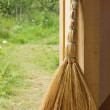 Stock Photo: Besom in doorway of wooden country house
