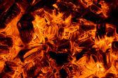 Burning embers in the dark — Stock Photo