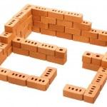 Red brick construction like unfinished house — Stock Photo #13716615