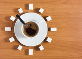 Cup of coffee with sugar like a clock — Stock Photo