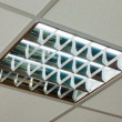 Office ceiling with built-in fluorescent shining lamp — Stock Photo #14100917
