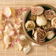 Dried rosebuds in teacup and petals top view — Stock Photo #14100918