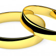 Two lying golden wedding rings — Stock Photo #18367245