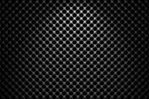 Steel grid with round holes under spot light — Foto Stock