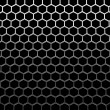 Stock Photo: Steel grid with hexagonal holes under top straight light