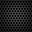 Stock Photo: Steel grid with hexagonal holes under round central light