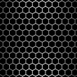 Stock Photo: Steel grid with hexagonal holes under straight central light