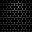 Stock Photo: Steel grid with hexagonal holes under spot light