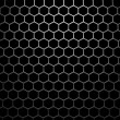 Stock Photo: Steel grid with hexagonal holes under wide spot light