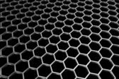 Steel grid with hexagonal holes in diagonal perspective view — Stock Photo
