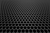 Steel grid with hexagonal holes in perspective view — Stock Photo