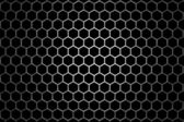 Steel grid with hexagonal holes under round central light — Stock Photo