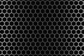 在左侧和右侧的光线下六角孔钢网格 — 图库照片