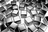 Steel cube in the crowd of scattered cubes — Stock Photo