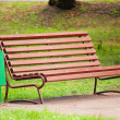 Old brown bench in park — Stock Photo