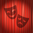 Red theater curtain with shadow of two masks — Stock Photo