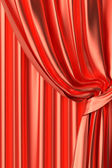 Red silk theater curtain fragment — Stock Photo