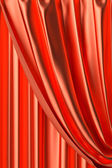 Red theater curtain fragment close-up view — Stock Photo