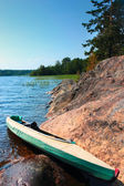 Canoe on the lake shore — Stock Photo