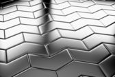 Steel arrow blocks flooring diagonal view — Stock Photo