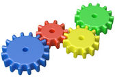 Colorful plastic toy cogwheels construction — Stock Photo