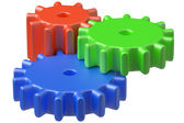 Three plastic toys cogwheels construction — Stock Photo
