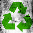 Recycle symbol painted on board with grungy dirty stains all over it - Stock Photo