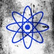 Stock Photo: Atom symbol painted on board with grungy dirty stains all over it