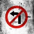 Stock Photo: No left turn road sign painted on board with grungy dirty stains all over it