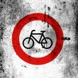 No Cycling road sign painted on board with grungy dirty stains all over it - Stock Photo