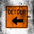 Detour road sign painted on board with grungy dirty stains all over it — Stock Photo