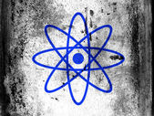 Atom symbol painted on board with grungy dirty stains all over it — Stock Photo